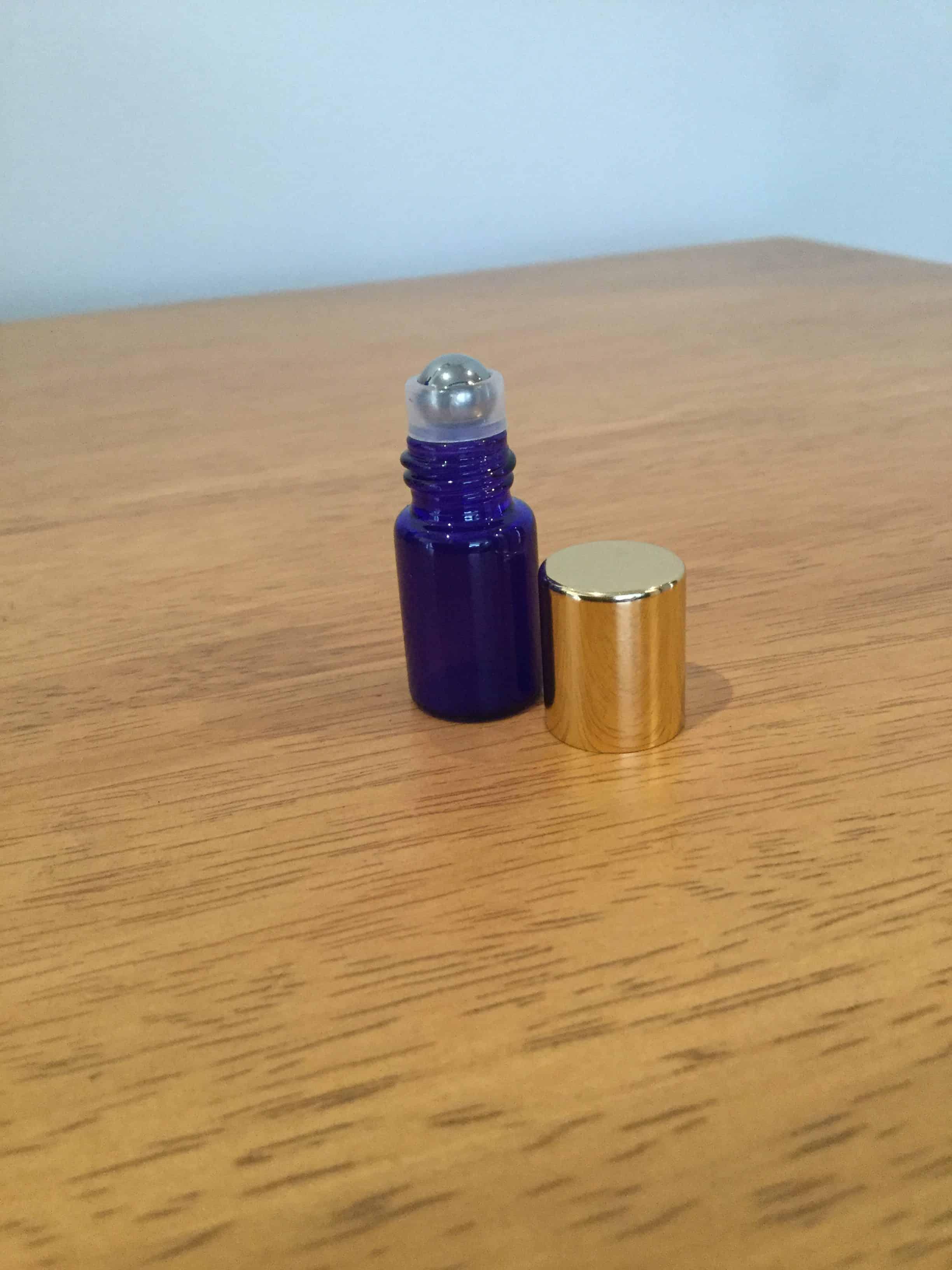 roller bottle 3ml glass blue steel roller gold lid lotus. Black Bedroom Furniture Sets. Home Design Ideas